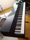 my nord grand in a black polished grand piano finish